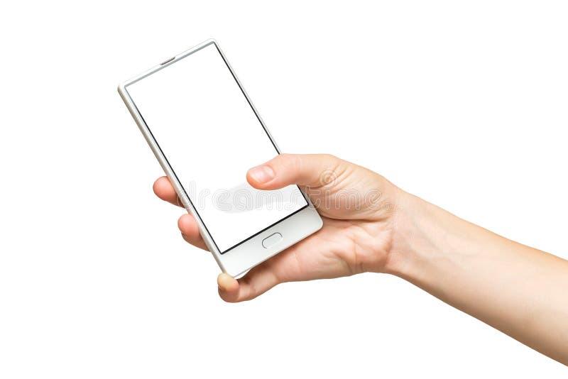 Maqueta de la mano femenina que sostiene el teléfono celular frameless con la pantalla en blanco foto de archivo libre de regalías