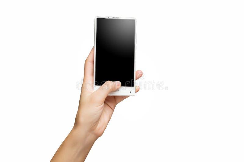 Maqueta de la mano femenina que sostiene el teléfono celular frameless con la pantalla negra fotos de archivo