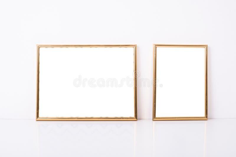 Maqueta de oro de dos marcos fotos de archivo libres de regalías