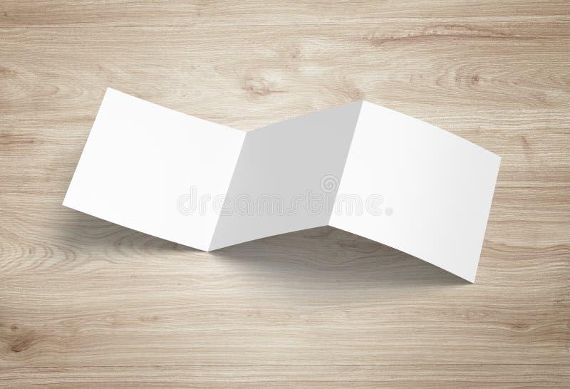 Maqueta del folleto aislada Folleto de papel triple en blanco de cernido sobre fondo fotos de archivo