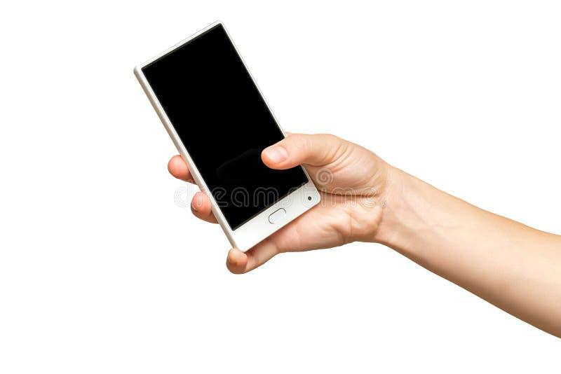 Maqueta del teléfono celular femenino de tenencia de la mano con la pantalla negra imagen de archivo