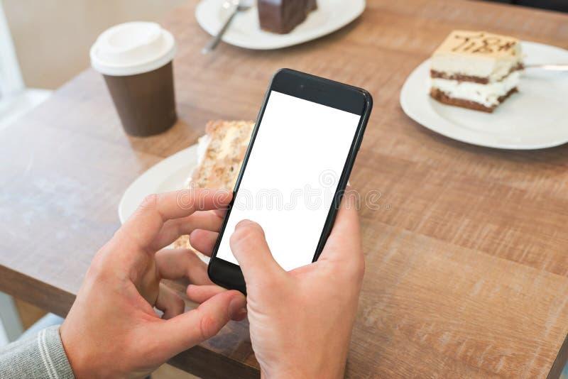 Maqueta elegante moderna del teléfono Sirva la célula de tenencia con la pantalla aislada para la presentación del app foto de archivo