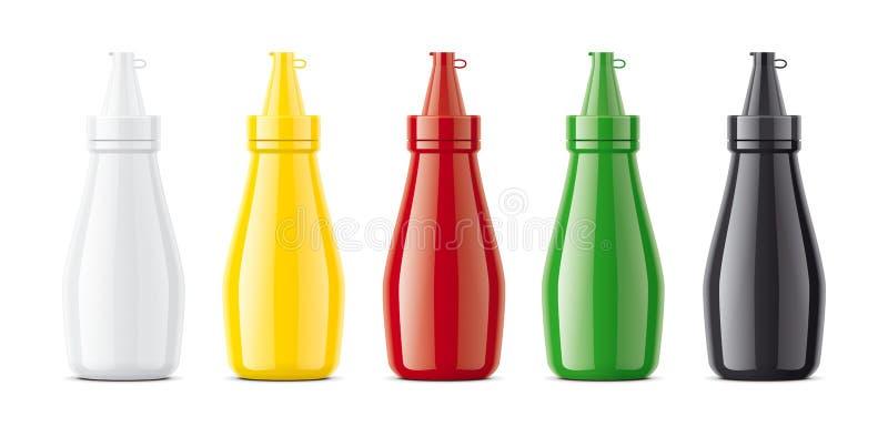 Maquetas plásticas de las botellas para las salsas fotos de archivo libres de regalías