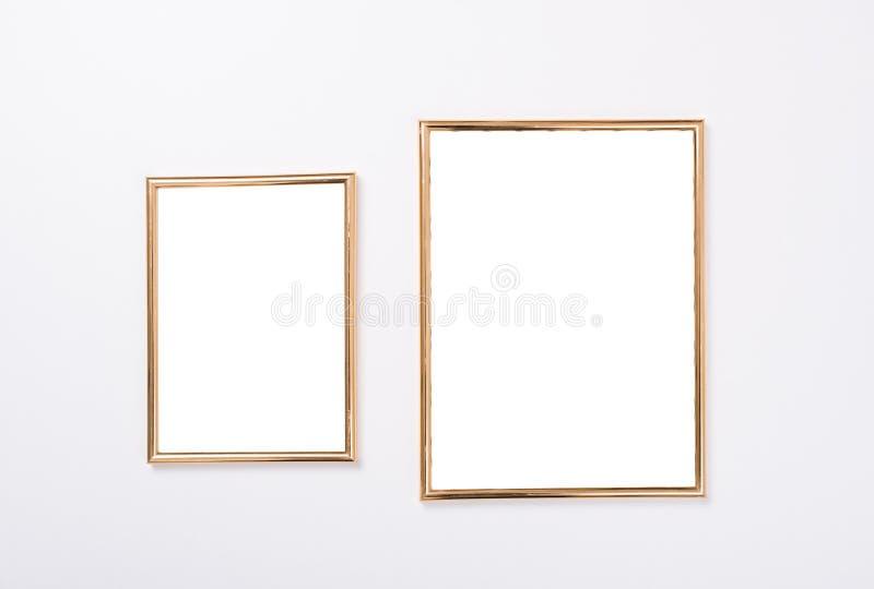Maquette d'or de deux cadres photos stock