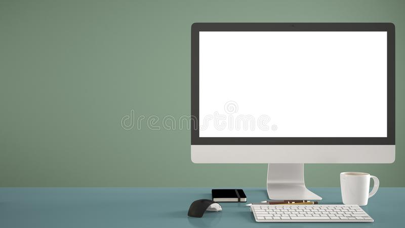 Maquette de bureau, calibre, ordinateur sur le bureau bleu de travail avec l'écran vide, souris de clavier et bloc-notes avec les image libre de droits