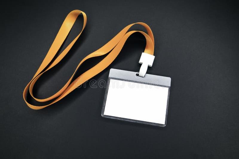 Maquette vide blanche d'identité de personnel avec la lanière orange images libres de droits