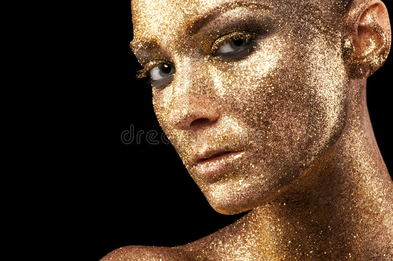 Maquillage d'or photographie stock