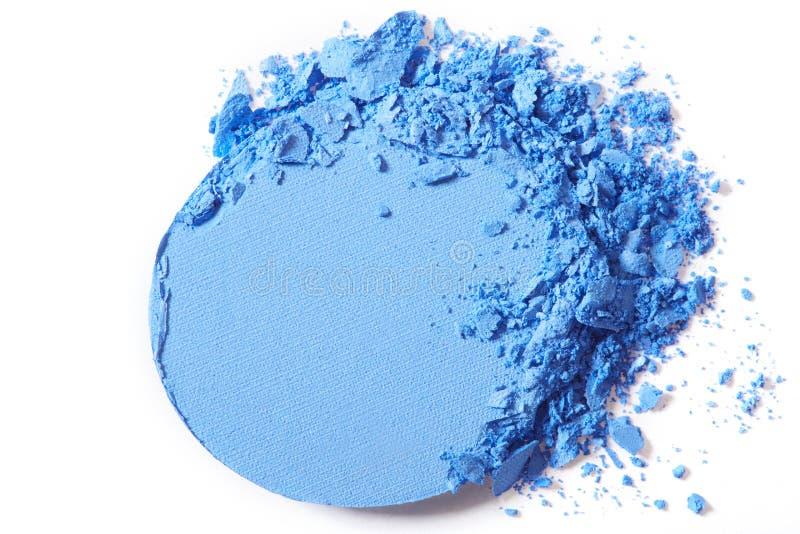Maquillaje azul de la sombra de ojos machacado fotografía de archivo