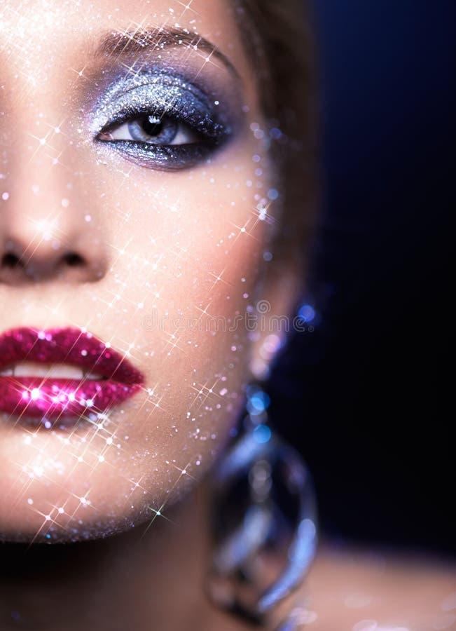 Maquillaje brillante de la cara de la mujer fotografía de archivo libre de regalías