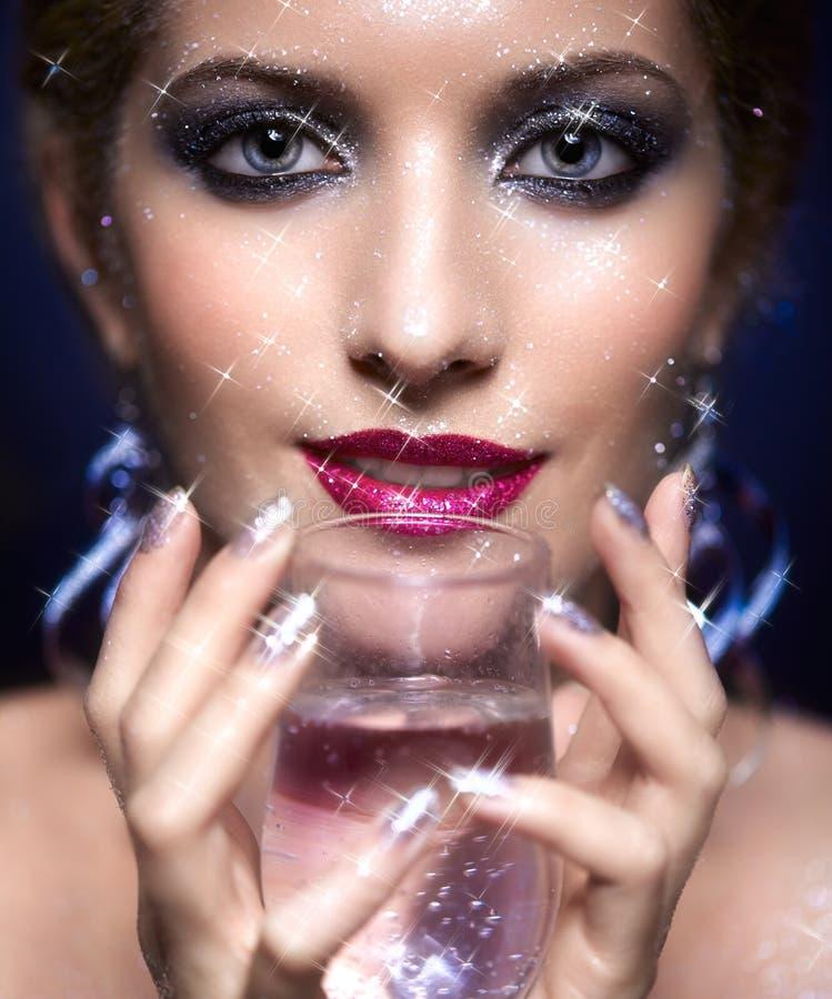 Maquillaje brillante de la cara de la mujer fotos de archivo