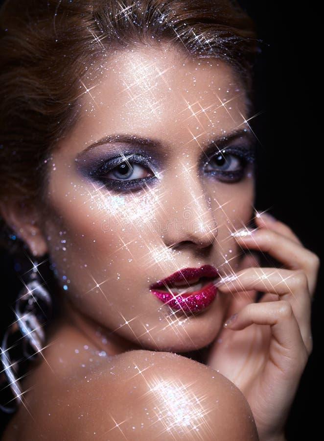 Maquillaje brillante de la cara de la mujer foto de archivo