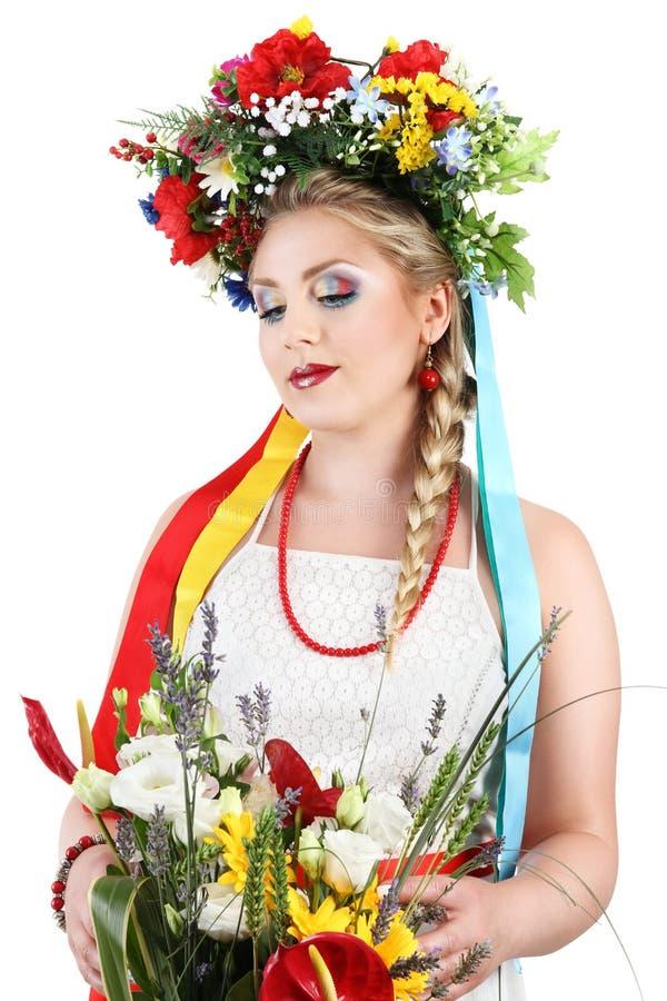 Maquillaje de la mujer con las flores en el fondo blanco, primavera foto de archivo libre de regalías