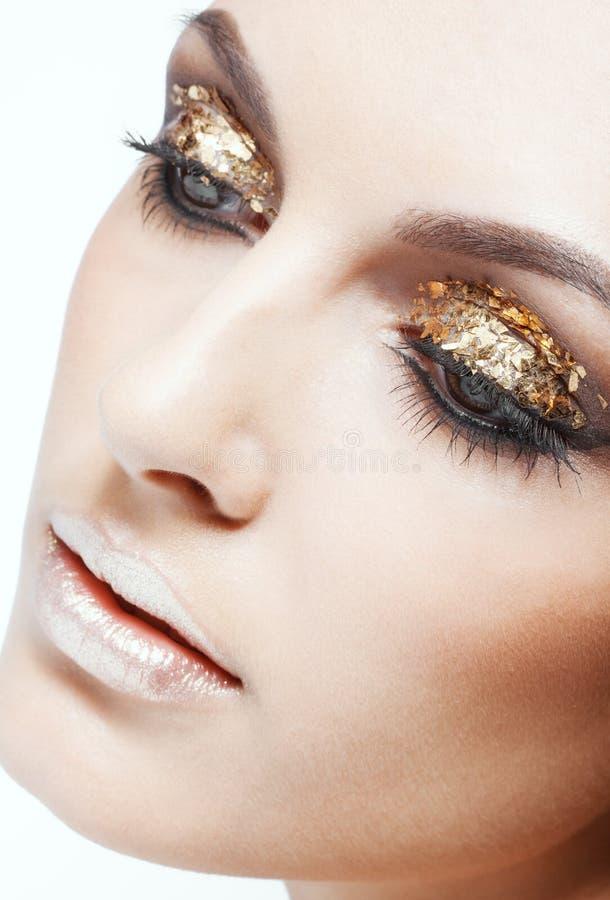 Maquillaje de oro del ojo fotos de archivo libres de regalías