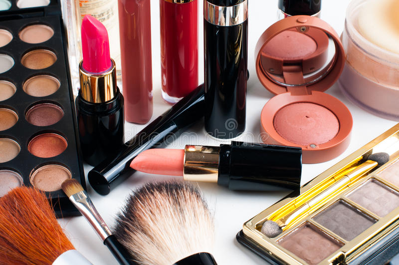 Maquillaje y cosméticos fijados fotografía de archivo