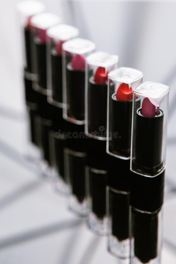 Maquilleur de rouges à lèvres du ` s de femmes d'éventail images stock