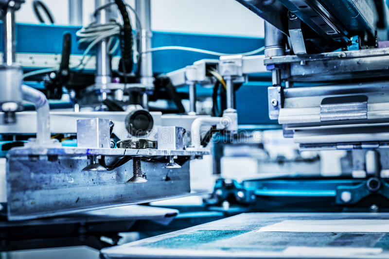 Maquinaria de impressão industrial do metal foto de stock royalty free