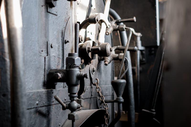 Maquinaria industrial vieja - extracto del detalle de la tecnología del vintage - foto de archivo