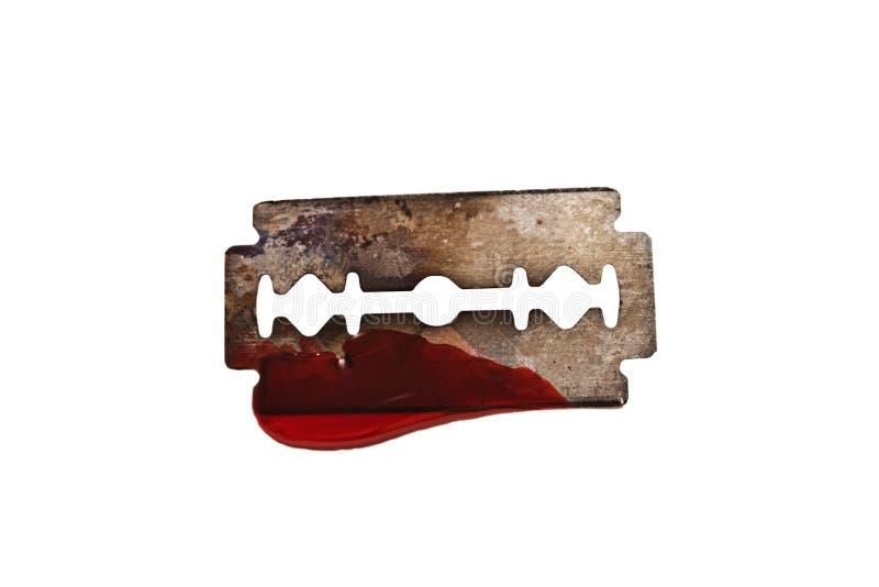Maquinilla de afeitar con la gota de la sangre aislada imagen de archivo