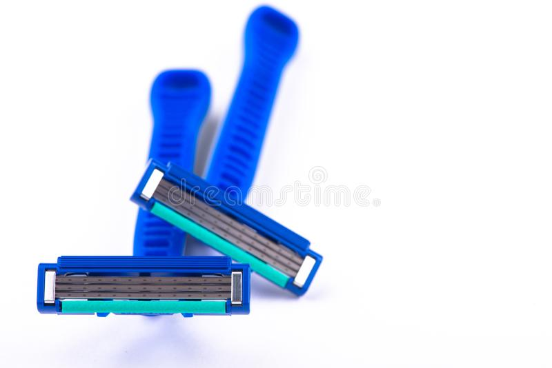 Maquinilla de afeitar en el fondo blanco Máquina para afeitar imagenes de archivo