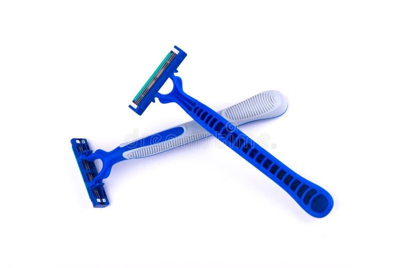 Maquinilla de afeitar en el fondo blanco Máquina para afeitar fotografía de archivo