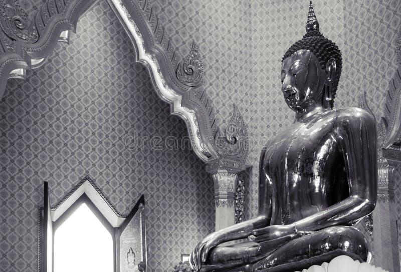 Pure gold Buddha sculpture at Wat Trimitr in China town Bangkok, Thailand royalty free stock image