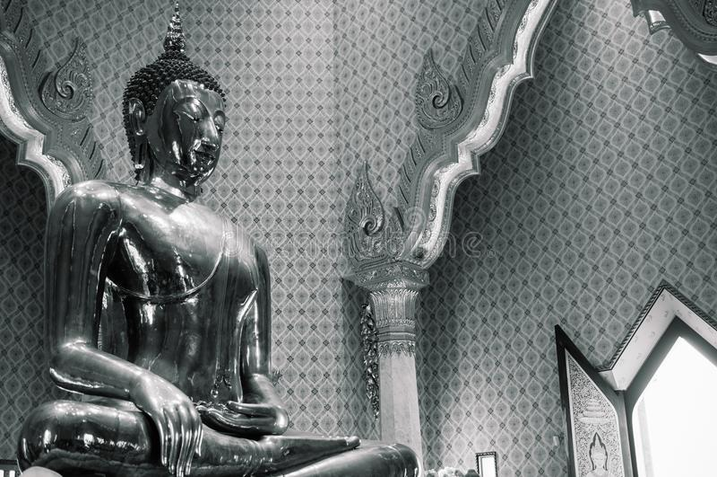 Pure gold Buddha sculpture at Wat Trimitr in China town Bangkok, Thailand stock photos