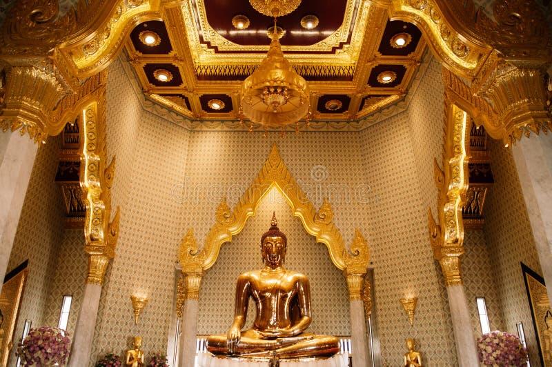Pure gold Buddha sculpture at Wat Trimitr in China town Bangkok, Thailand royalty free stock photos