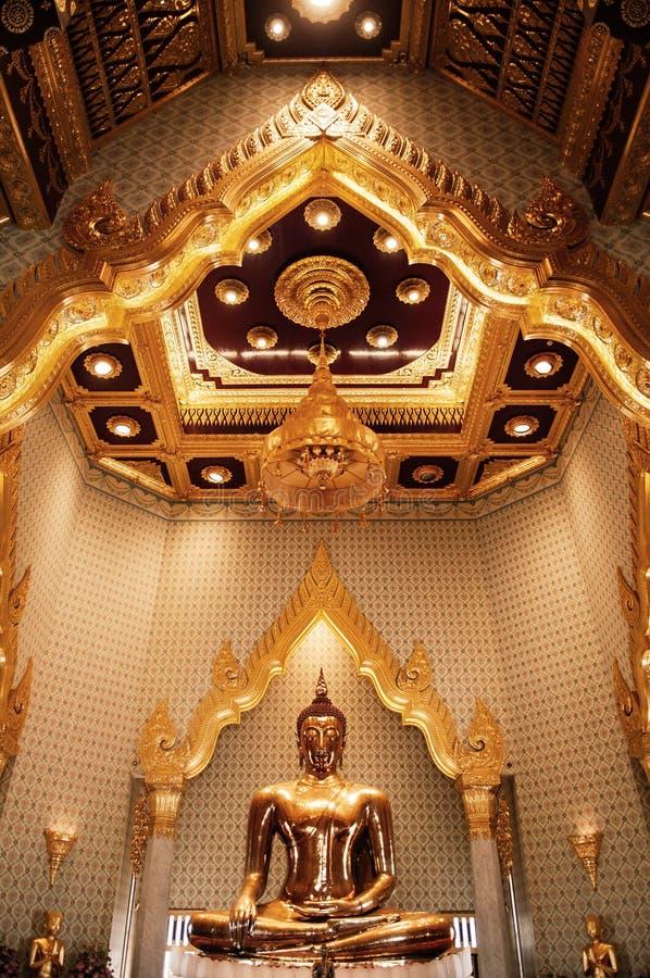 Pure gold Buddha sculpture at Wat Trimitr in China town Bangkok, Thailand royalty free stock photo