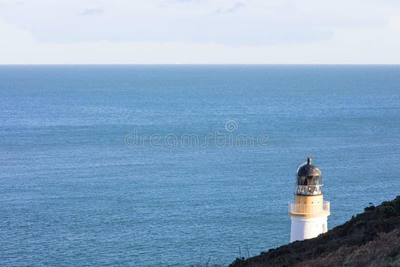 Mar da Irlanda e farol Douglas Isle do homem foto de stock