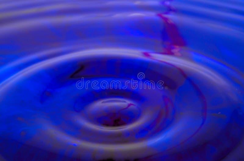 Fundo da água azul e vermelha imagem de stock