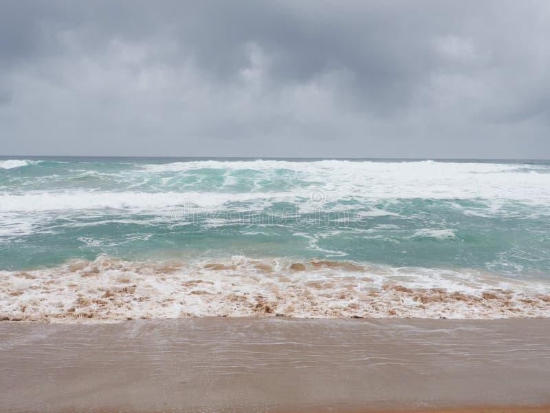 Mar e areia de tempestade imagem de stock royalty free