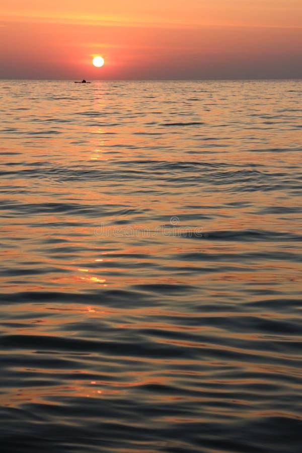 Mar e por do sol fotos de stock