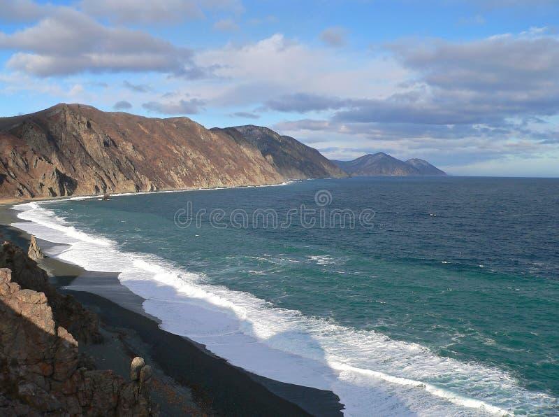 Mar, nubes y resaca. fotografía de archivo