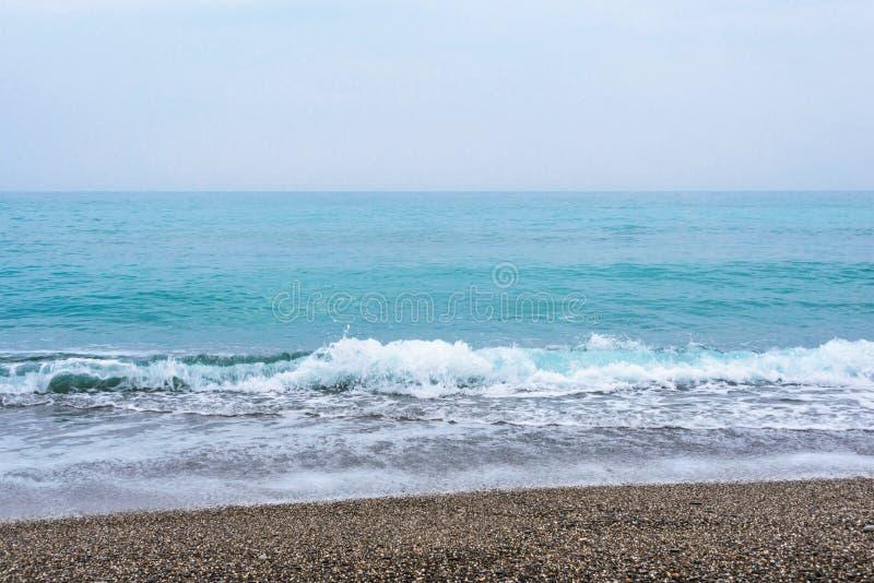 Mar, ondas, arena foto de archivo
