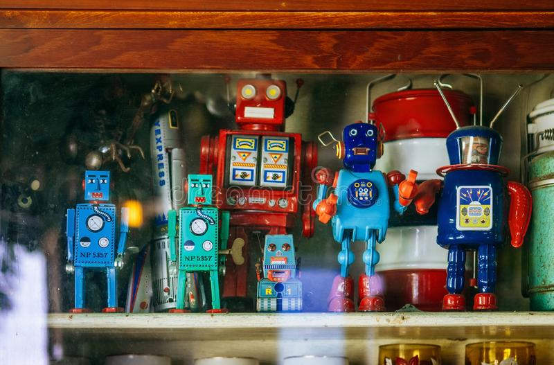 Group of colourful vintage retro tin toy robot team stock image