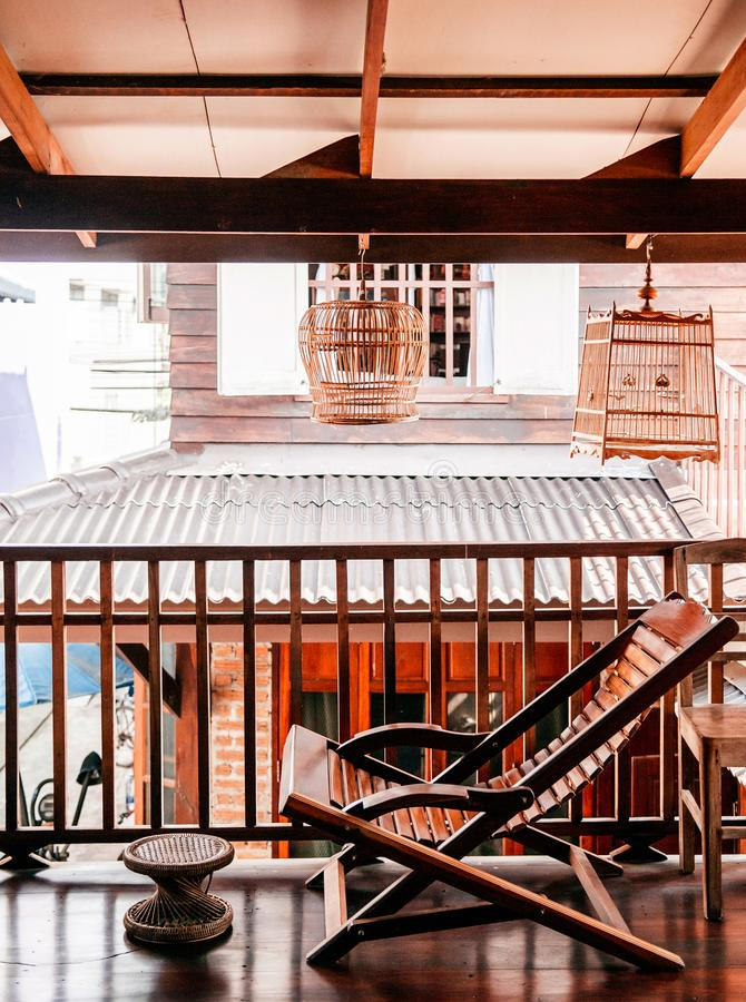 Rustic wooden vintage recliner chair country house interior concept decoration for Thai style house stock photography