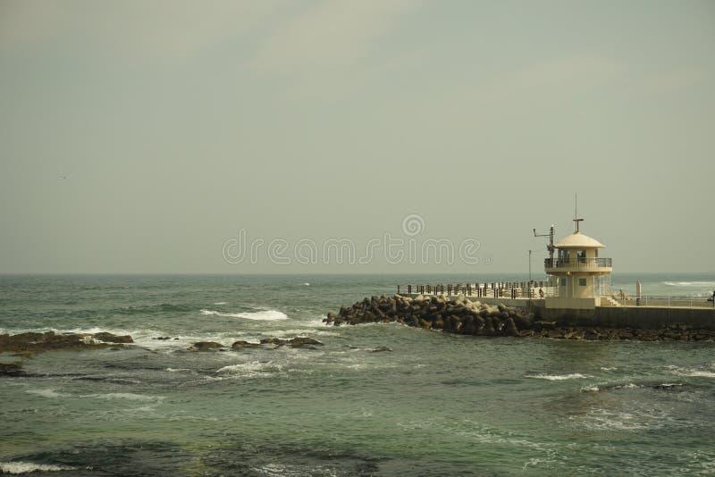 Mar y faro foto de archivo libre de regalías