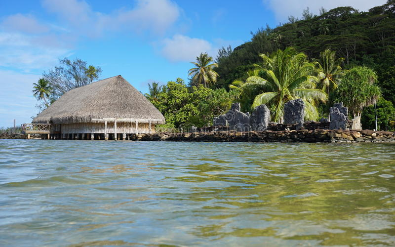 Marae and Fare Potee shore lake French Polynesia. Marae and Fare Potee on the shore of the lake Fauna Nui, Maeva, Huahine island, French Polynesia royalty free stock photo