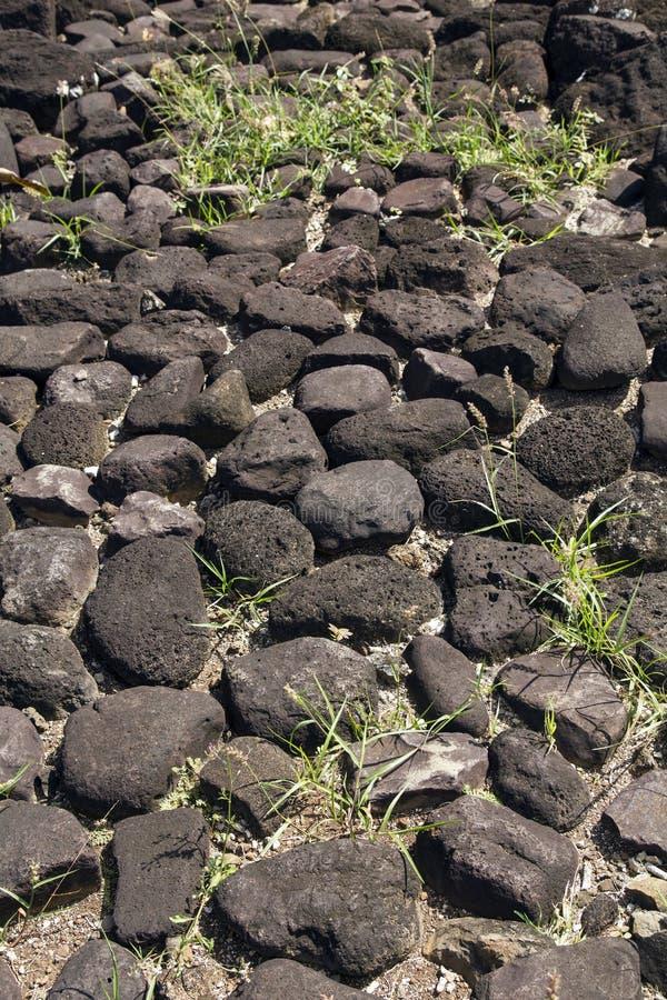 Marae Felsenfußboden stockbilder