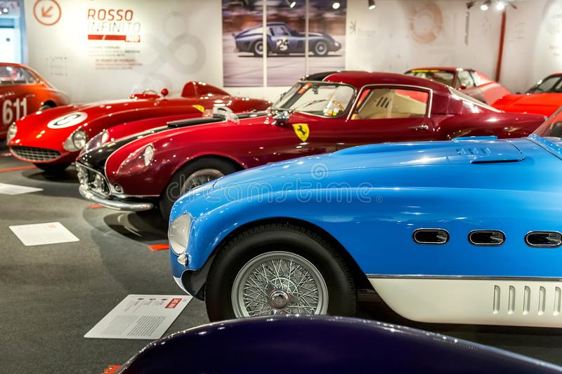 Maranello, Italy – July 26, 2017: Exhibition in the famous, popular Ferrari museum Enzo Ferrari of sport, race cars and f1. royalty free stock images