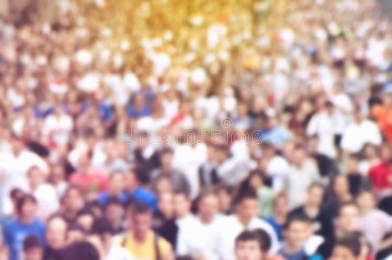 Maratón corriente de la gente de Defocus de la falta de definición foto de archivo