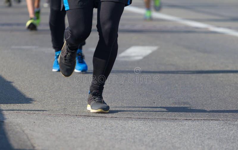 Maratón corriente de la raza de la gente fotografía de archivo libre de regalías