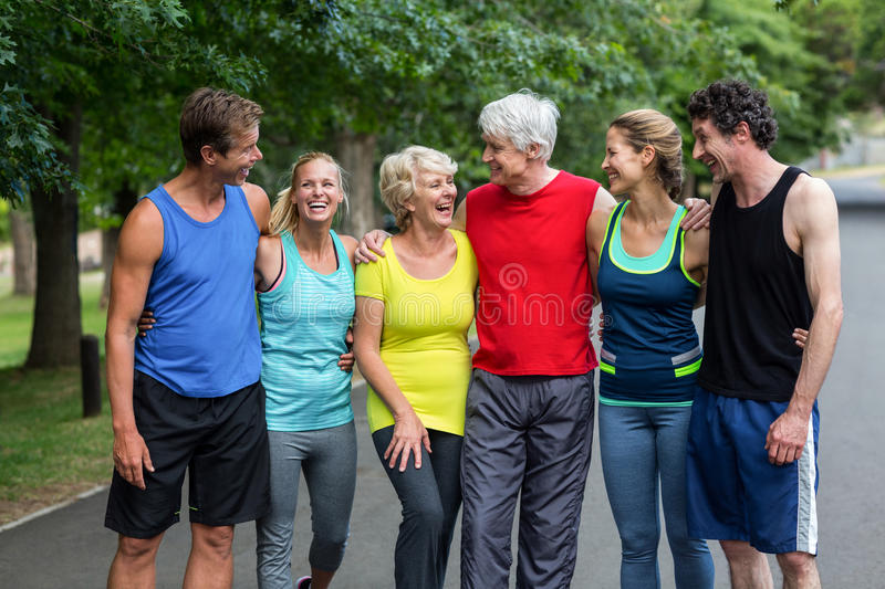Marathon athletes posing and laughing royalty free stock photography