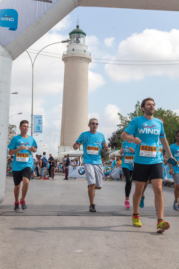 Marathon in Greece. GREECE, ALEXANDROUPOLIS - SEPTEMBER 27, 2015: Competitors run during the second edition of the ''Run Greece''. Organizers are Segas, Wind and stock photography