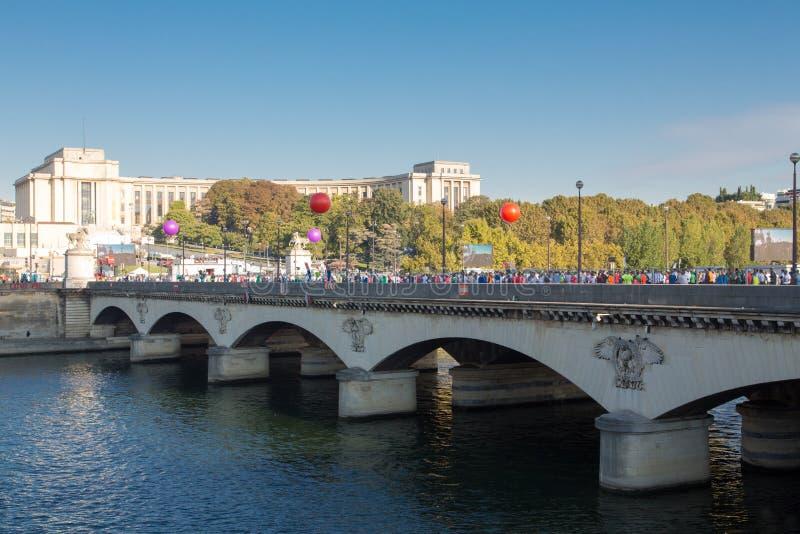 Marathon of Paris, France. View of the crowd preparing to run in front of Iéna Bridget near the Effeil Tower stock photo