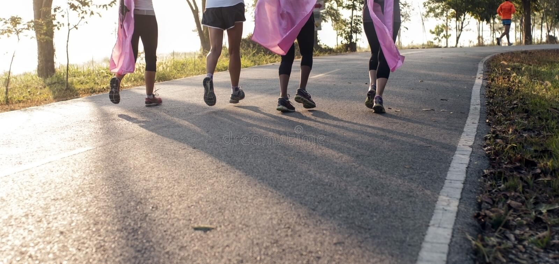 Marathon run for cancer, pink ribbon charity stock photo