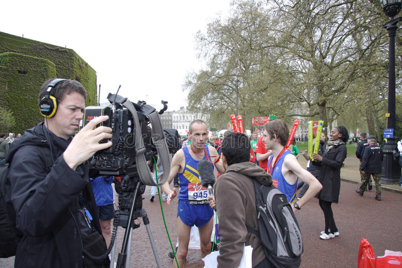 Marathon runner having a television interview royalty free stock images