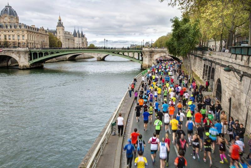 Marathon runners in paris stock photography