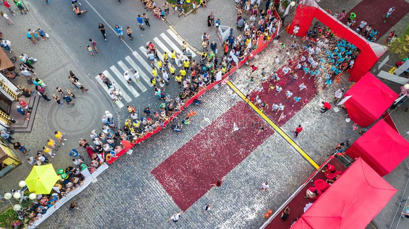 Marathon running race, aerial view of start and finish line with many runners from above, road racing, sport competition stock photography