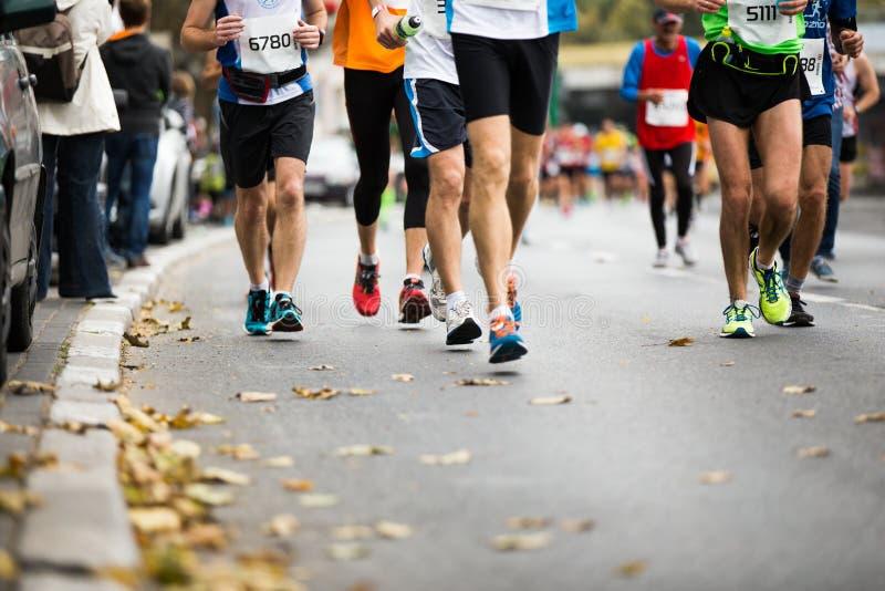 Marathon running race, people feet royalty free stock image